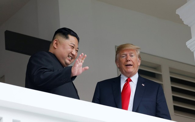 US President Donald Trump talks with North Korean leader Kim Jong Un at the Capella Hotel on Sentosa island in Singapore June 12, 2018. Reuters