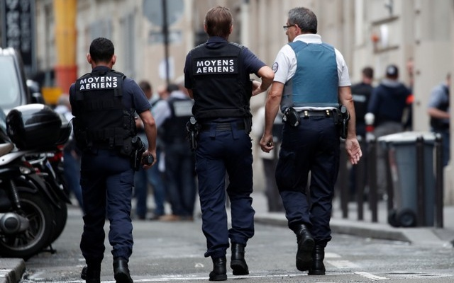 Special French police advance in the street as a man has taken people hostage at a business in Paris, France, June 12, 2018.Reuters