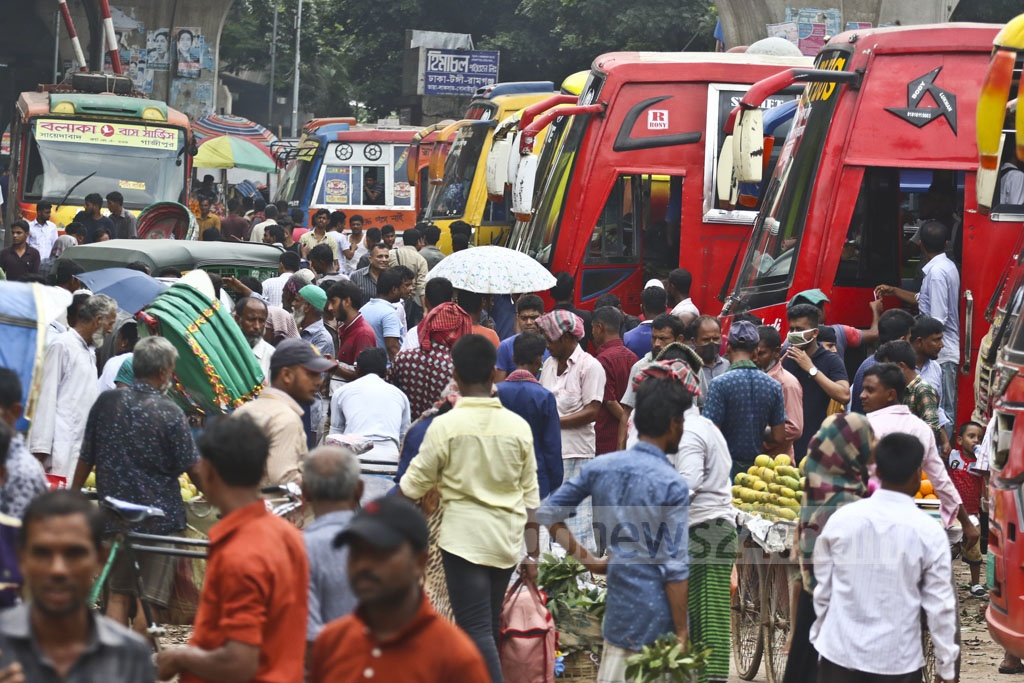 Holidaymakers flock to Sayedabad Bus Terminal in Dhaka on Tuesday to celebrate the Eid with loved ones back in their town and village homes. Photo: Abdullah Al Momin