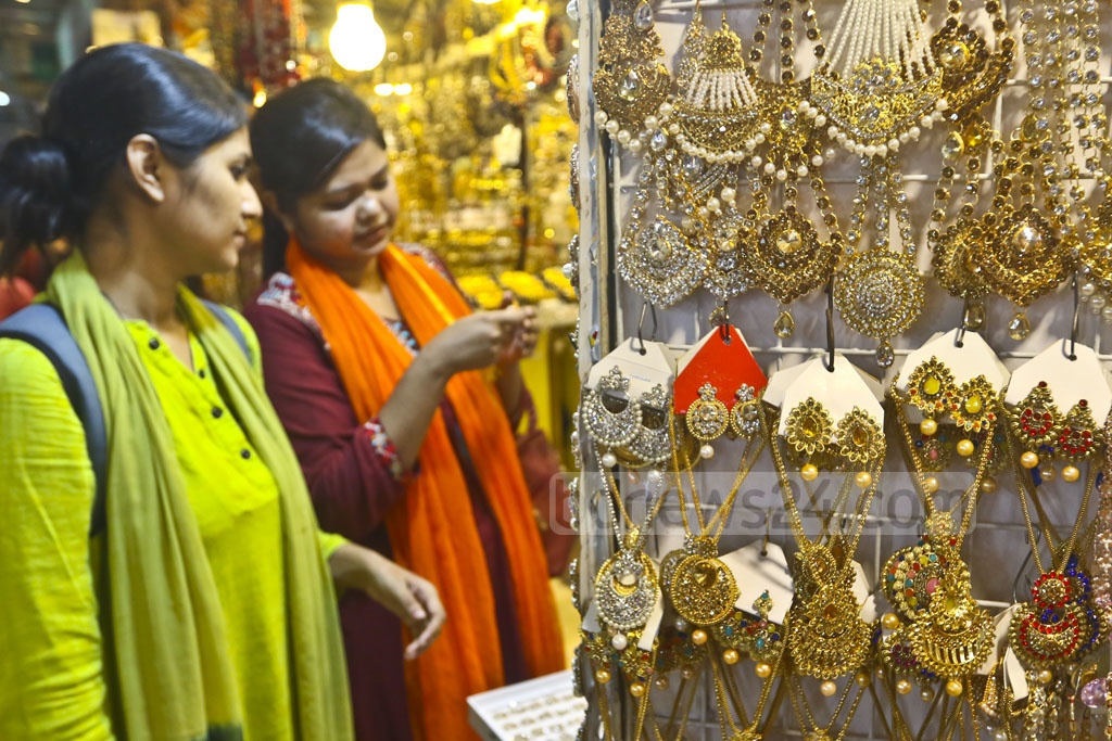 Women are buying matching cosmetics, jewellery and handbags to go with new dresses. The photo was taken at Dhaka's Gausia market on Wednesday. Photo: Abdullah Al Momin