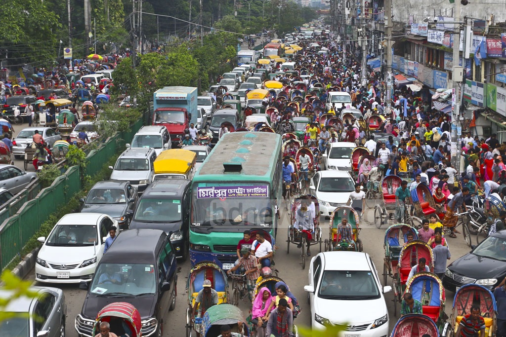 Huge crowds of Eid shoppers created traffic congestion on Mirpur Road in Dhaka on Wednesday. Photo: Abdullah Al Momin