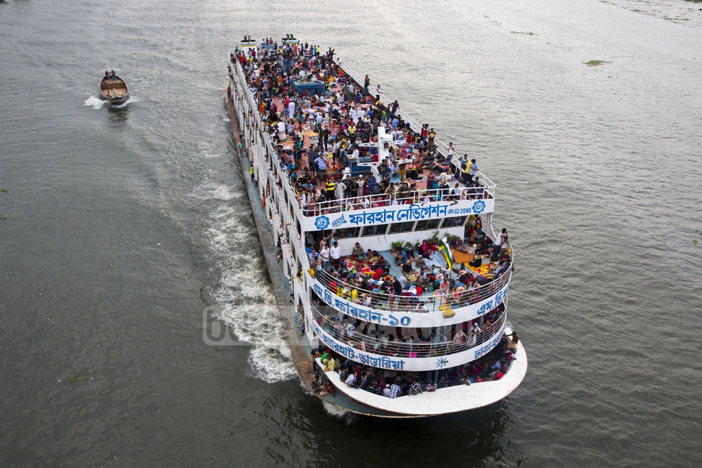 Many travelled home from Dhaka by launches on Friday to celebrate Eid-ul-Fitr with their families. This photo was taken from the China-Bangladesh Frienship Bridge on the Burhiganga River at Postogola. Photo: Mostafigur Rahman