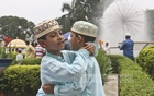 Two boys greet each other with the traditional Eid hug at the National Eidgah after the prayer service on Saturday. Photo: Abdullah Al Momin