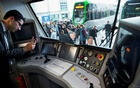 A man takes a picture of the cockpit of a Desiro City passenger train by Siemens Mobility at the InnoTrans railway technology trade fair in Berlin, Sept 25, 2014. Reuters