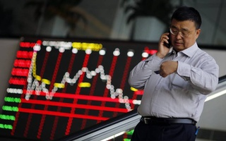 A man is seen inside the Shanghai Stock Exchange in Changhai's Pudong financial district on Nov 17, 2014. Reuters