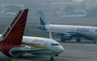 File Photo: An IndiGo Airlines Airbust A320 aircraft and JetKonnect Boeing 737 aircraft taxi past an Air India Airbus A321 aircraft at Mumbai's Chhatrapathi Shivaji International Airport February 3, 2013. Reuters