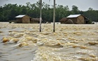Partially submerged houses are seen at a flood-affected village in Hojai district, in the northeastern state of Assam, India, June 16, 2018. Reuters