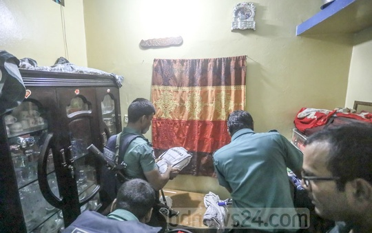 Police looking for narcotics at a house in the Mohammadpur's Geneva Camp on Wednesday.