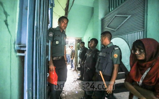 Police running an anti-drugs drive in the Mohammadpur's Geneva Camp on Wednesday.