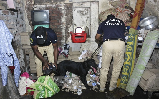Police aided by their sniffer dogs conduct an anti-drug drive on Laalbagh in Dhaka on Thursday.