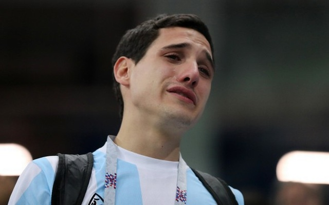 Argentina fan looks dejected after the match. Reuters