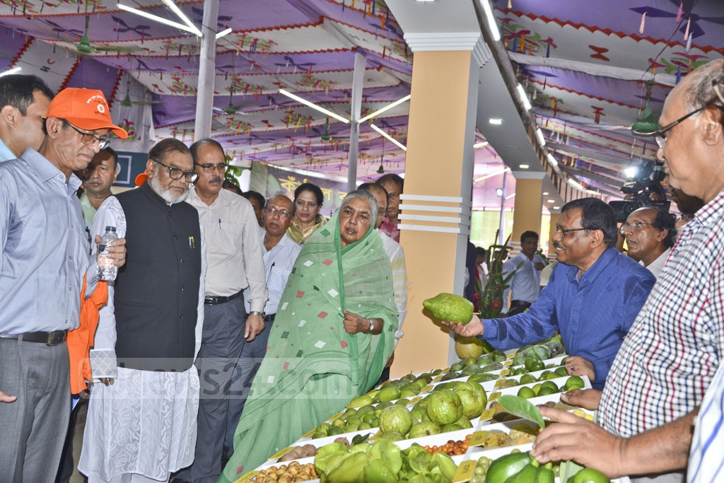 Agriculture Minister Matia Chowdhury and Liberation War Affairs Minister AKM Mozammel Huq visit a three-day fruit fair organised by the Ministry of Agriculture on the Gias Uddin Milky Auditorium premises at Khamarbari in Dhaka on the opening day on Friday.