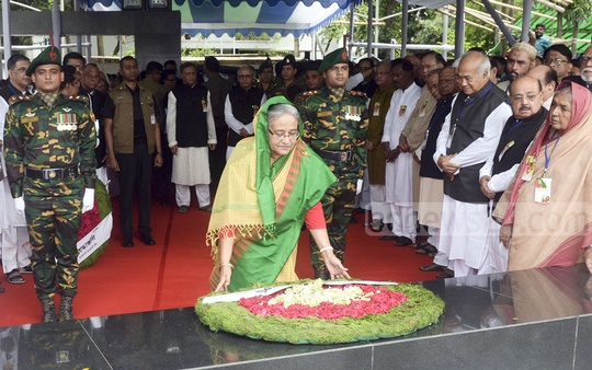 Prime Minister Sheikh Hasina pays her respects to the Father of the Nation Bangabandhu Sheikh Mujibur Rahman on the 69th anniversary of the founding of the Awami League in front of his portrait at Dhanmondi Road 32. Photo: PID