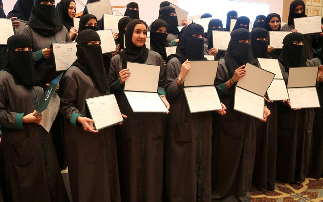 Saudi women hold their diplomas during the graduation ceremony of women car-accident inspectors. REUTERS