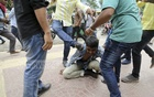 Quota protesters are attacked in front of the Central Shaheed Minar in Dhaka on Monday. Photo: Mahmud Zaman Ovi