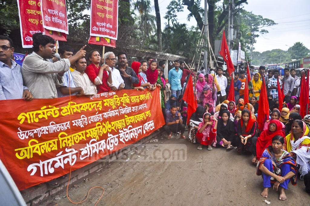Garment Workers' Trade Union Centre demonstrates in front of the National Press Club in Dhaka on Thursday demanding that the minimum monthly wage be raised to Tk 16,000.