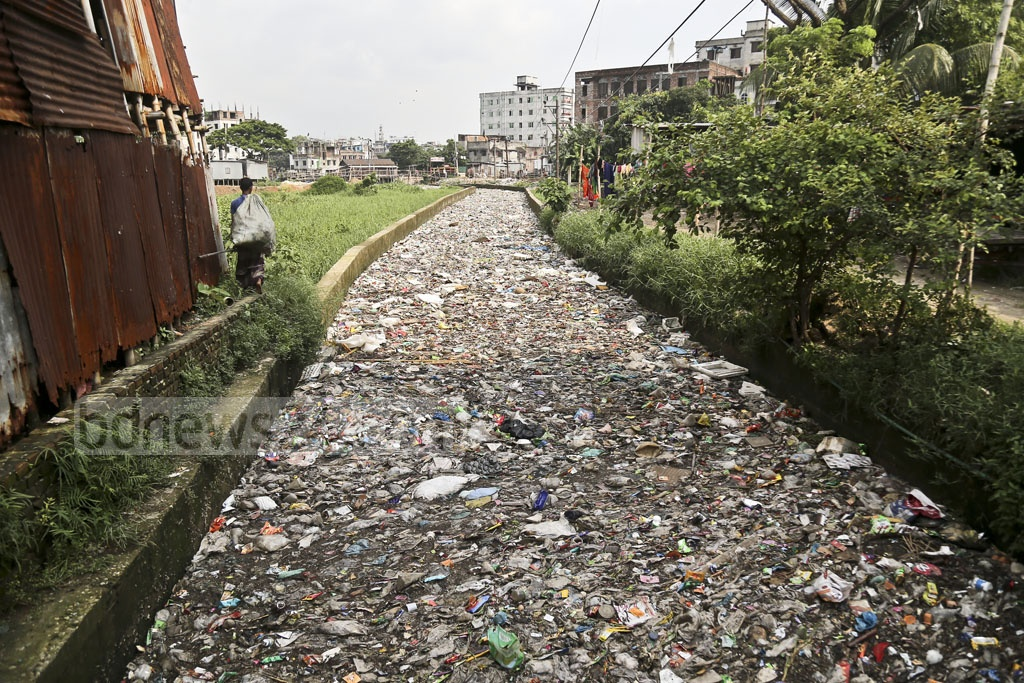 Three-year-old Hridoy lost his life last year in this canal in Dhaka's Mugda neighbourhood. It took six days to recover the body from the canal due to garbage. Almost eight months into the tragic incident, the canal remains the same as before. Photo: Mahmud Zaman Ovi