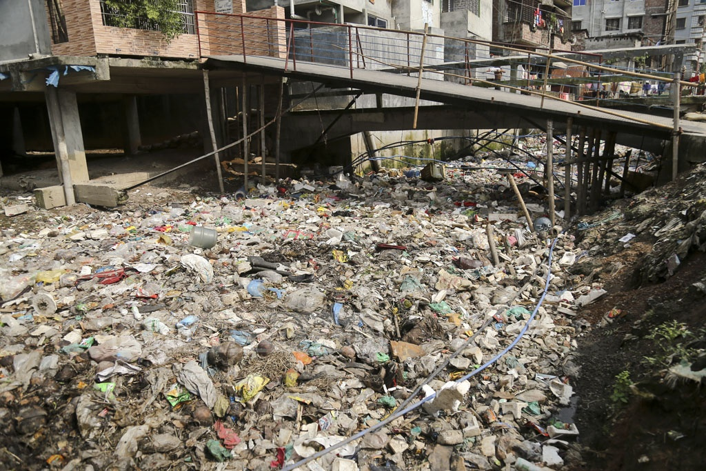 The Madinabagh Canal at Manda in Dhaka's Mugda is so much filled up with garbage, especially polythene and plastic materials, that it is impossible to spot water in it.
