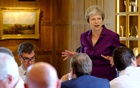 May wins support from divided UK government on Brexit plan