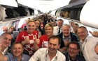 Croatian President Kolinda Grabar-Kitarovic takes a photo with passengers aboard a Jul 1 flight to Russia. Facebook/Kolinda Grabar-Kitarović