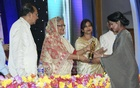 Nusrat Imrose Tisha receives Best Actress award from Prime Minister Sheikh Hasina.