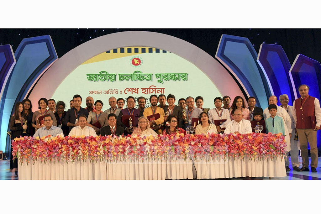 Prime Minister Sheikh Hasina poses for a photograpgh with movie actors and professionals who were recognised for their outstanding contributions to the cinema industry.
