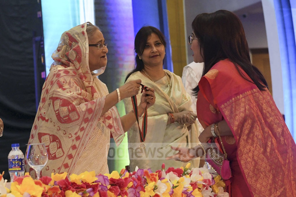 Farida Akter Babita receiving Lifetime Achievement Award from Prime Minister Sheikh Hasina.
