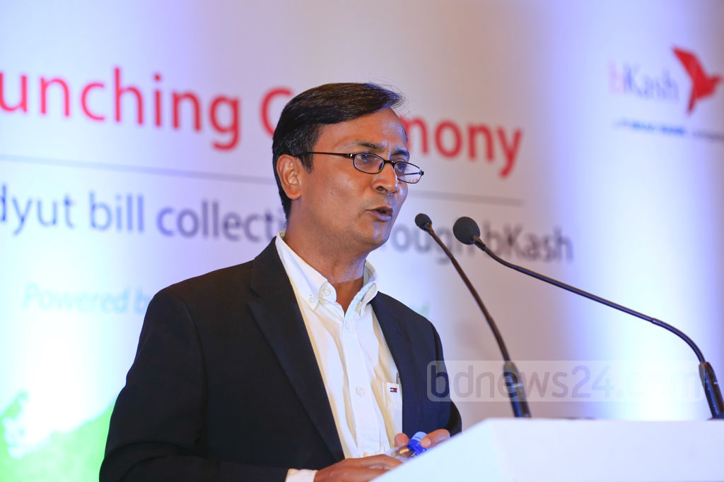 bKash Chief Commercial Officer Mizanur Rashid speaks at the launch of bill payment service for Palli Bidyut consumers through the mobile financial service provider at a Dhaka hotel on Monday. Photo: mostafigur rahman