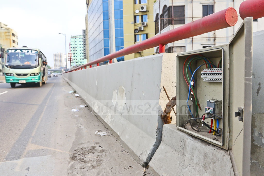 Parts of Moghbazar flyover's circuit breaker boxes have been stolen and lids of the boxes have also been taken away, raising possibilities of accidents being caused by those unprotected boxes. Photo: Abdullah Al Momin