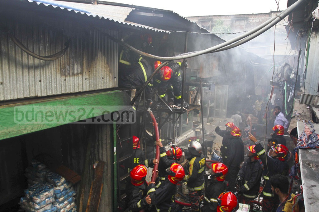 Fire crews trying to douse a fire that broke out at the Hasina Market in Dhaka's Karwan Bazar on Wednesday.