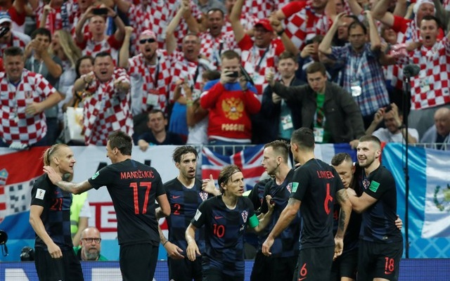 Croatia's Ivan Perisic celebrates scoring their first goal with teammates. Reuters