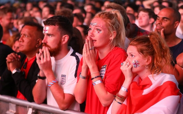 England fans react during the match. Reuters