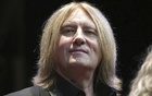 FILE PHOTO: Def Leppard singer Joe Elliott sits on stage during an announcement that Kiss and Def Leppard will team up this summer for a 42-city North American tour, at the House of Blues in West Hollywood, California March 17, 2014. REUTERS