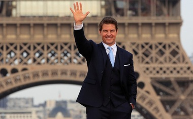 Cast member Tom Cruise poses in front the Eiffel Tower during the world premiere of the film