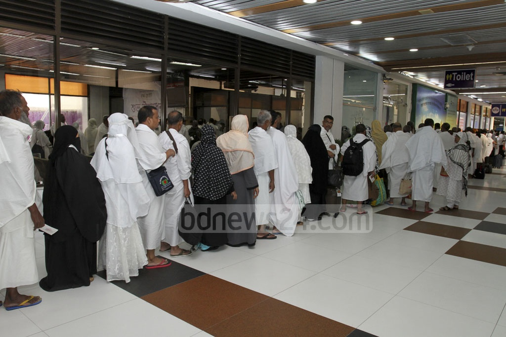 Passenger board the first of this year's Hajj flights at Dhaka's Hazrat Shahjalal International Airport on Saturday. Photo: Mostafigur Rahman