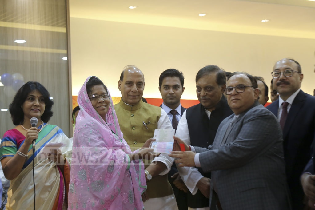 Indian visas are presented to some at the inaugural ceremony of the new Indian Visa Application Centre in Dhaka. Photo: Mahmud Zaman Ovi