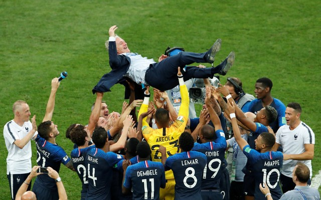 France coach Didier Deschamps is thrown into the air by his players as they celebrate after winning the World Cup. Reuters
