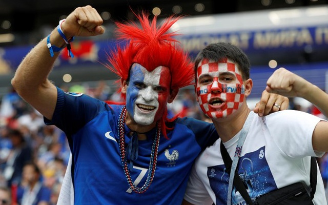France fan and a Croatia fan pose for a photo inside the stadium before the match. Reuters