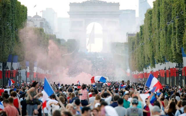 France fans react on the Champs-Elysees avenue after defeating Croatia in their World Cup final match. Reuters