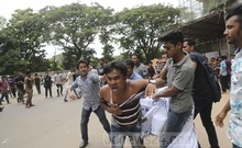 Attackers beat a student in front of the Bangabandhu Tower at the Dhaka University during a demonstration demanding the release of quota reform protesters on Sunday. Photo: Mahmud Zaman Ovi