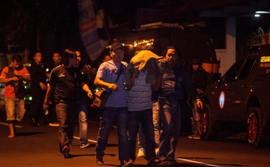 Police detain a suspect following the shooting of three suspected Islamic militants in Sleman, Yogyakarta, Indonesia Jul 14, 2018. Reuters