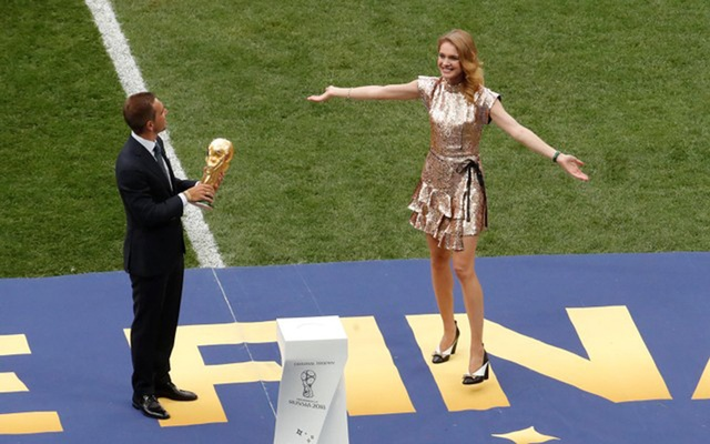 Philipp Lahm with the World Cup Trophy on the pitch before the match. Reuters