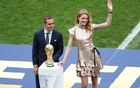 Former Germany player Philipp Lahm and Russian supermodel Natalia Vodianova during the presentation of the World Cup trophy before the match. Reuters