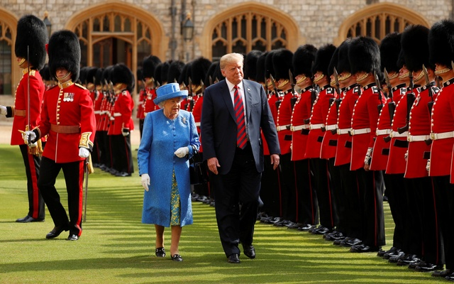 US President Donald Trump and Britain's Queen Elizabeth inspect the Coldstream Guards during a visit to Windsor Castle in Windsor, Britain, Jul 13, 2018. Reuters