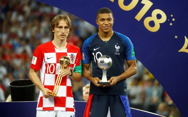 Croatia's Luka Modric poses with the FIFA Golden Ball award as France's Kylian Mbappe poses with the FIFA Young Player award. Reuters