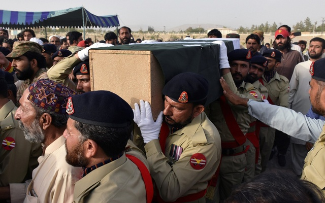 Army soldiers carry the casket of Siraj Raisani, provincial assembly candidate of Baluchistan Awami Party (BAP), who was killed in Friday's suicide attack during an election campaign meeting, for the funeral in Quetta, Pakistan Jul 14, 2018. Reuters