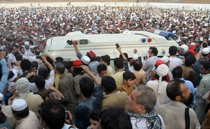 People gather around an ambulance carrying the coffin of Awami National Party (ANP) candidate Haroon Bilour who was killed among others on Jul 10's suicide attack during an election campaign meeting, in Peshawar, Pakistan July 11, 2018. Reuters