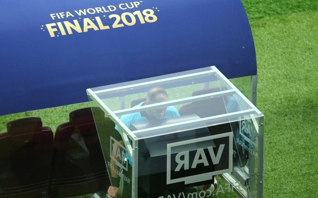 Referee Nestor Pitana checks VAR before the penalty is awarded. Reuters
