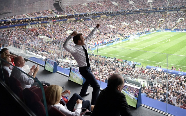 French President Emmanuel Macron reacts during the game. Sputnik/Kremlin via Reuters