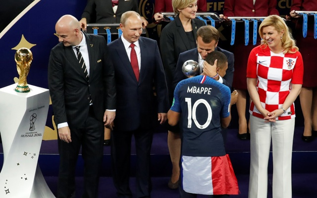 France President Emmanuel Macron hugs France's Kylian Mbappe as Russia President Vladimir Putin and Croatia President Kolinda Grabar-Kitarovic watch. Reuters
